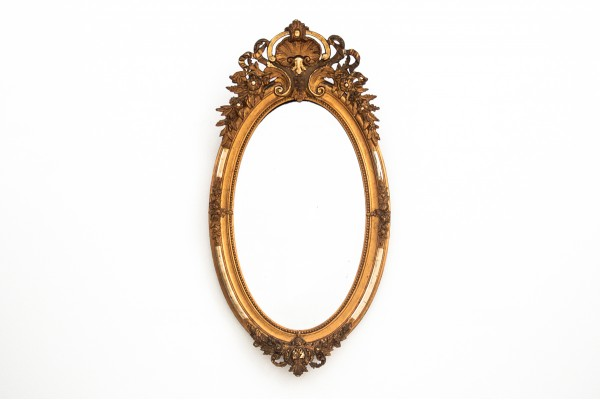 An Antique Mirror In A Golden Frame From The Beginning Of The 20th Century